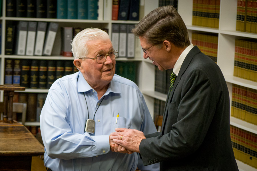 Dean Toben greets Senator Watson with a handshake