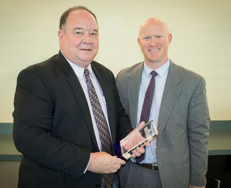 Judge Cates oposes with Matt Czimskey, while receiving his award
