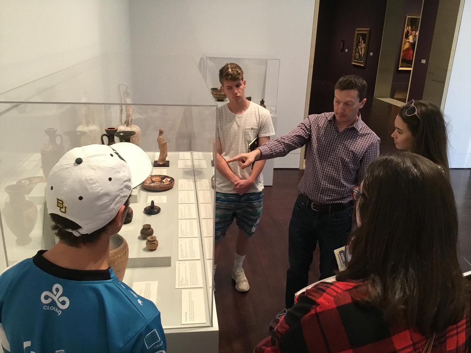Dr. Nathan Elkins Studying Greek Pots with Students at the Blanton Museum