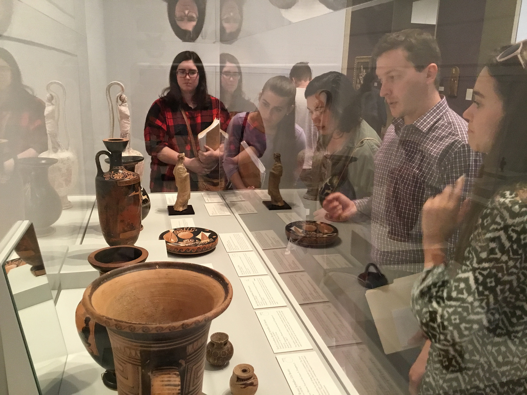 Dr. Nathan Elkins Studying Greek Vessels with Students at the Blanton Museum