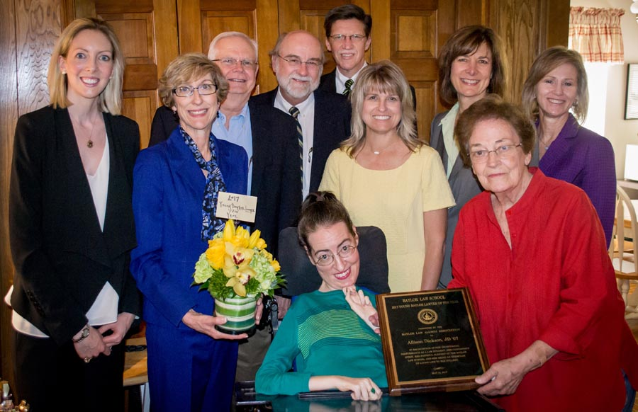 Allison and her family and friends gather to celebrate her award