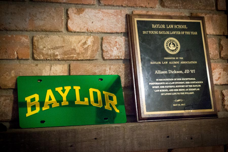 Allison's license plate and award plaque sit side-by-side