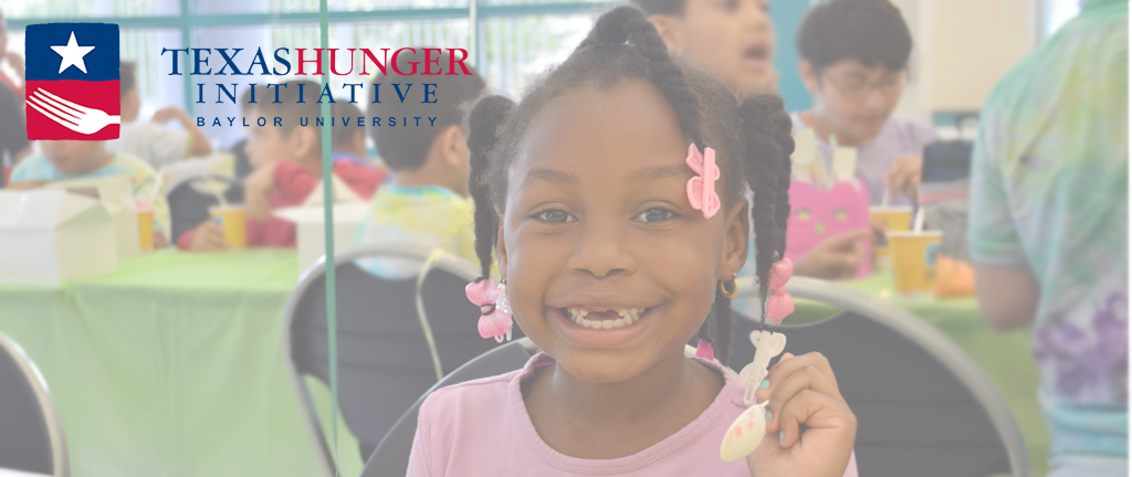 girl smiling at summer meals site