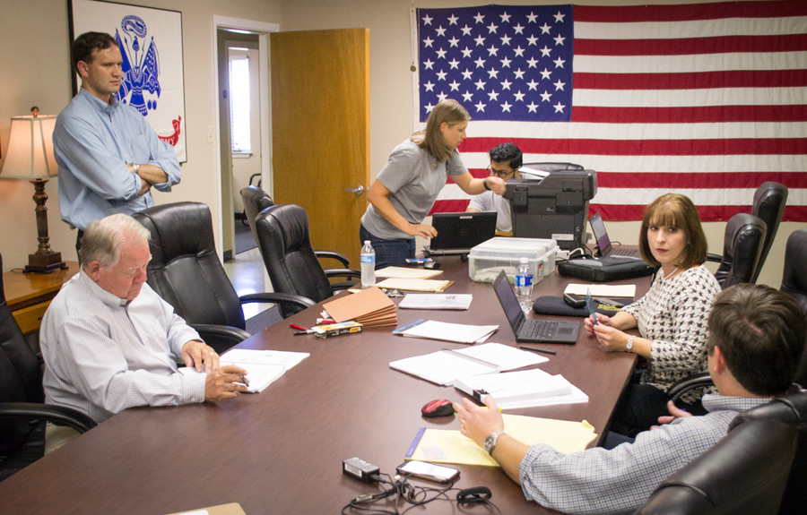 Professor Fuselier and Josh Borderud volunteer, offering legal help to a room full of veterans