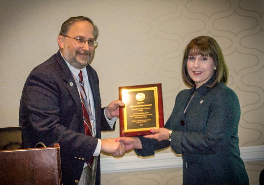 Professor Bridget Fuselier accepts the Colonel Bryan S. Spencer award