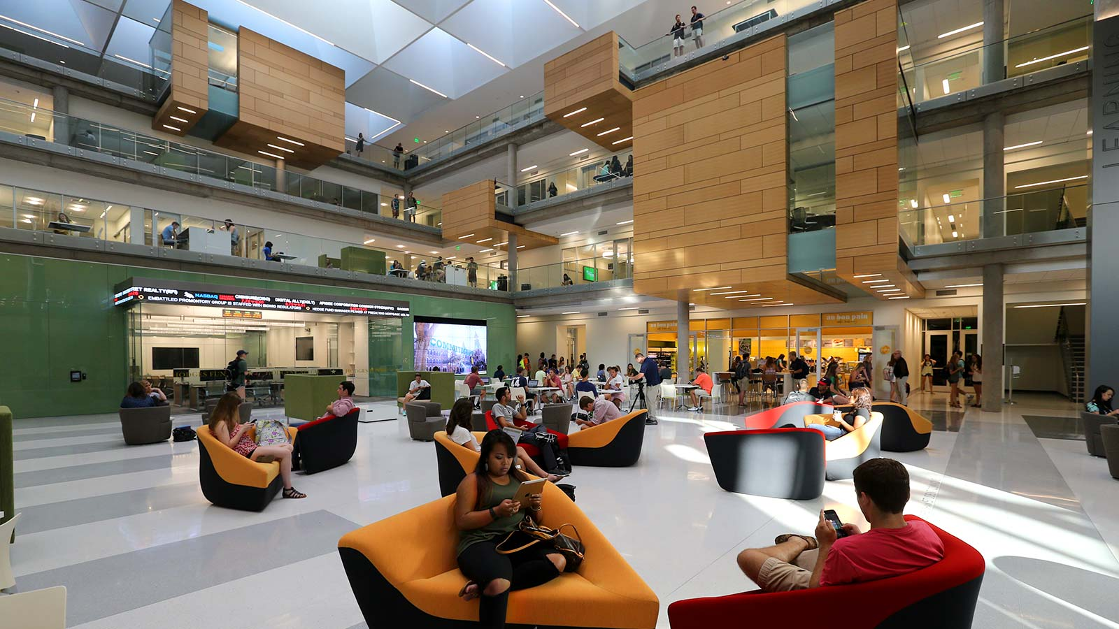 Students lounge and fellowship in the expansive atrium of the Paul L. Foster Campus for Business and Innovation. The Foster campus was dedicated in 2015 and serves as the home of the Hankamer School of Business.