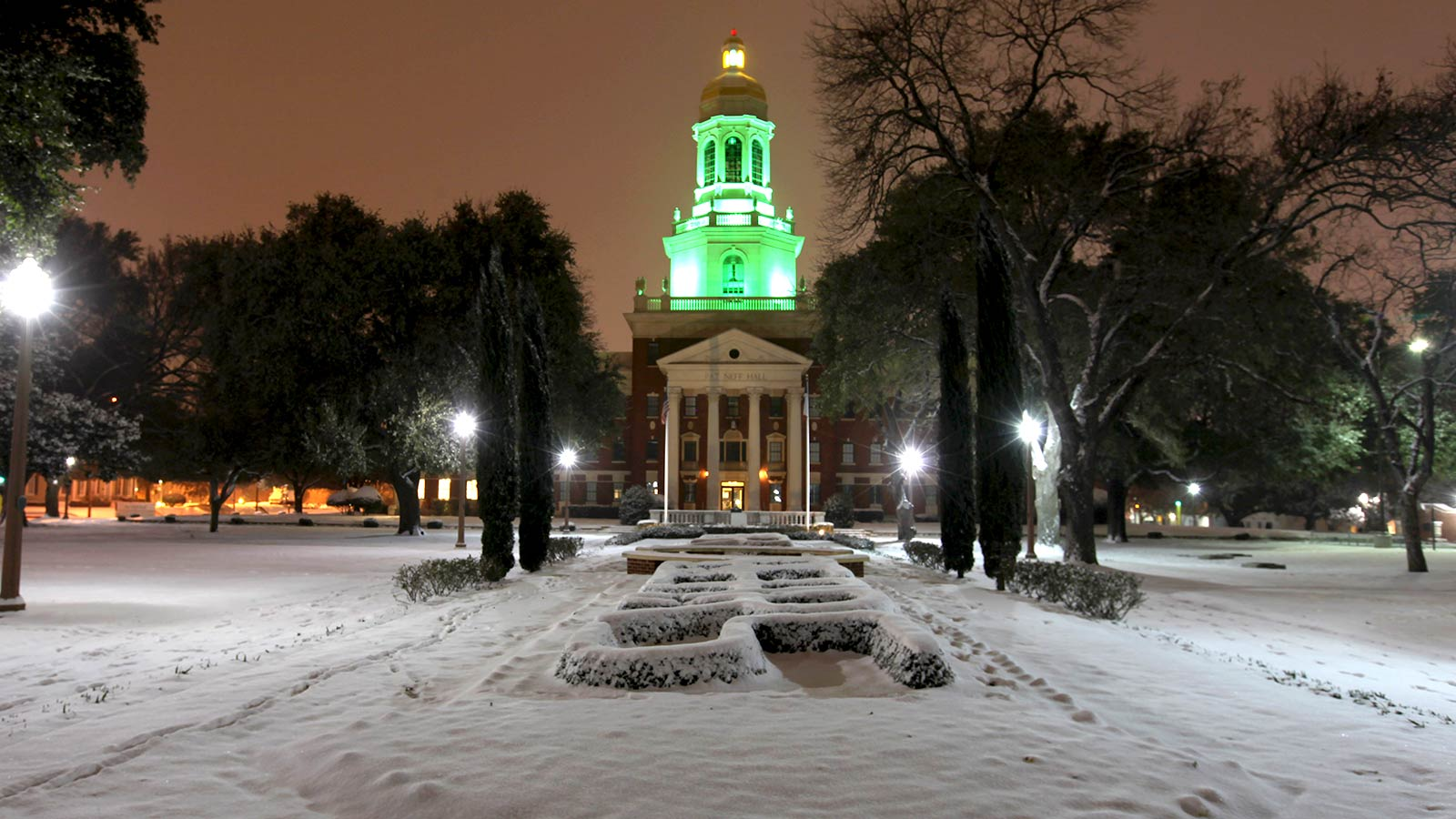 Occasionally, Waco receives a dusting of snow that gives Pat Neff Hall and Founders Mall a wintry beauty. The green lit dome reflects another  home athletic victory.