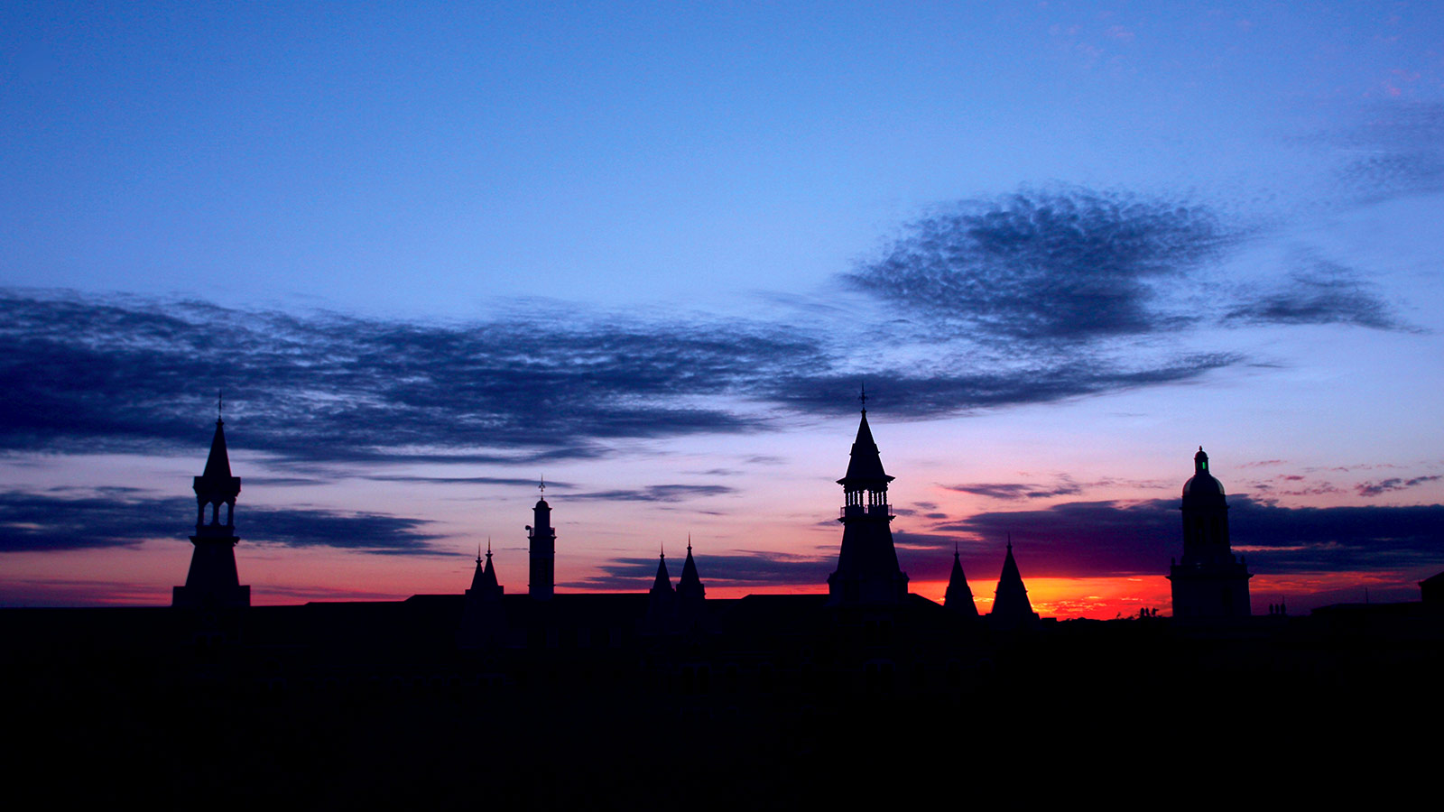 The spires of Burleson and Old Main and the dome of Pat Neff frame a beautiful Central Texas sunset.