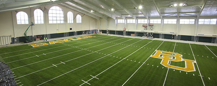 With this indoor facility, weather conditions no longer will result in canceled practices. In addition, the synthetic playing surface will complement the two natural grass practice fields adjacent to the facility, preparing the Baylor football team for all playing conditions.