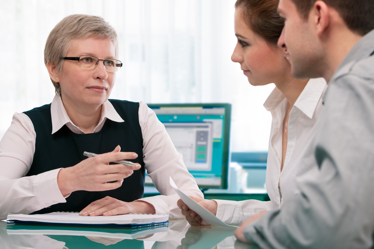 Stock photo of businesswoman counseling a young couple