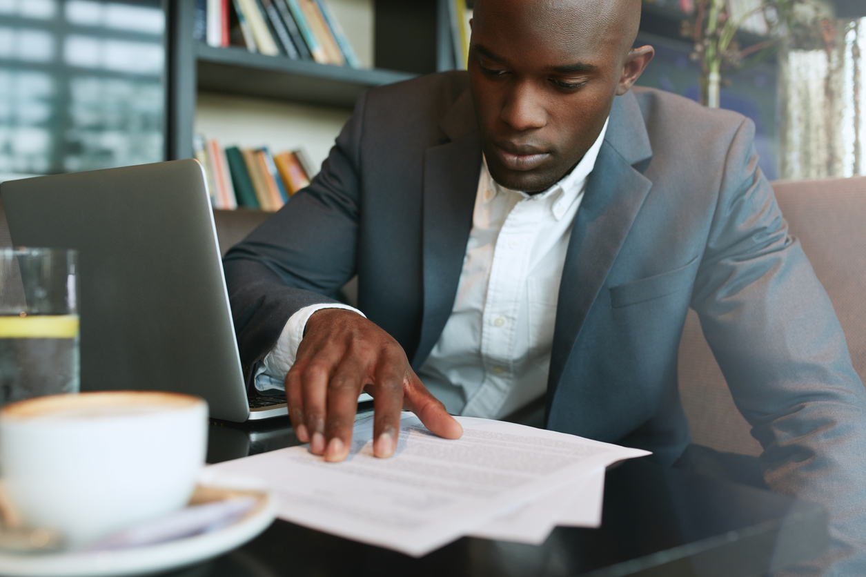 Stock photo of a businessman looking over paperwork