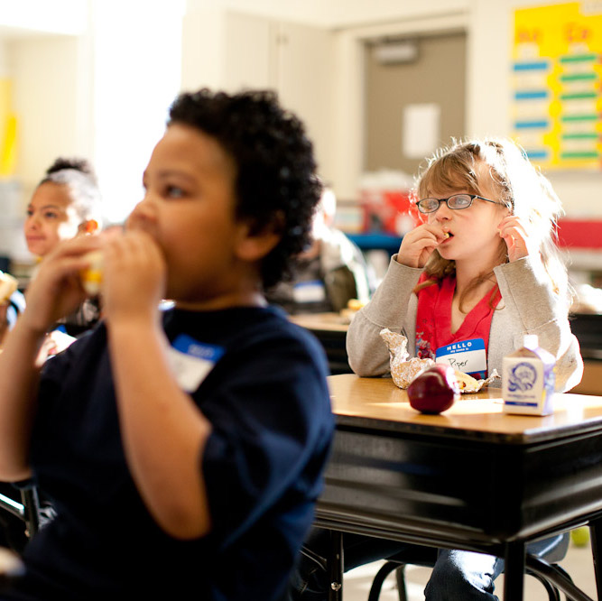 students eating breakfast in their classroom
