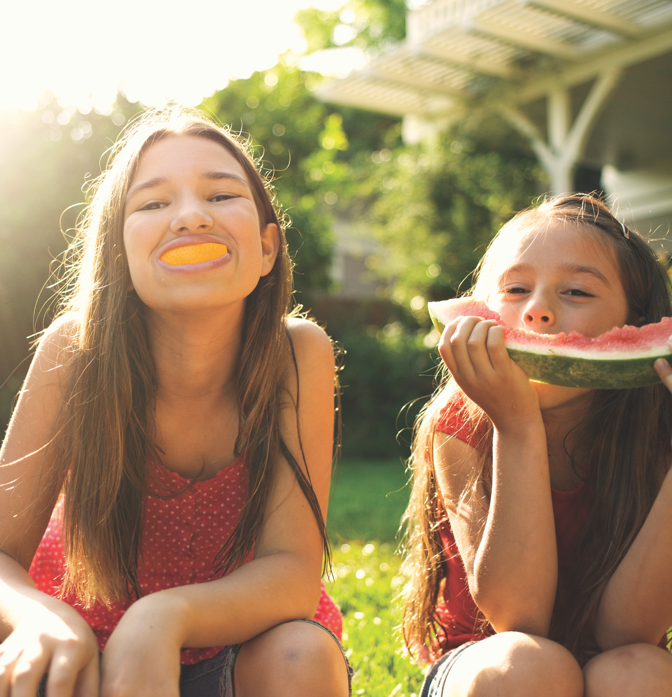 happy kids eating fruit in the summer