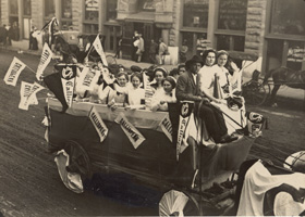 Archival Sepia-toned image of first automobiles in Baylor Homecoming Parade