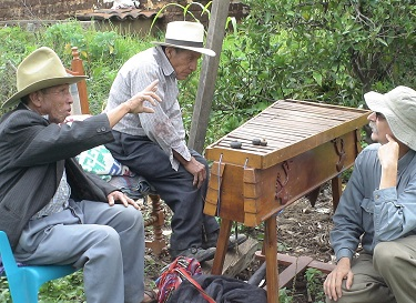 Construction of a percussion instrument from wood in the jungle