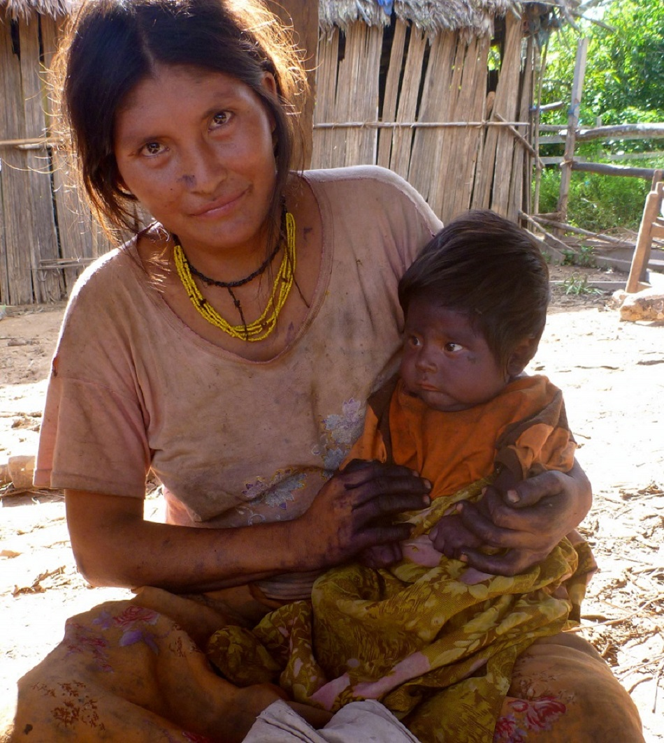 A mother holds her child in a developing nation