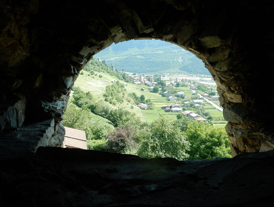 A view of the cityscape looking out of a cavern