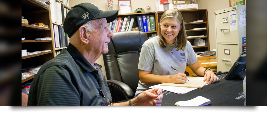 A Baylor Law Student counsels a veteran on legal matters in an office
