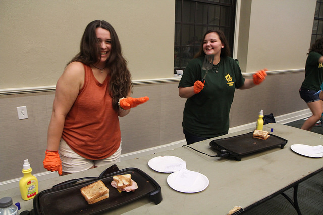 <i>Student volunteers serve as Toasties chefs for the evening.</i>