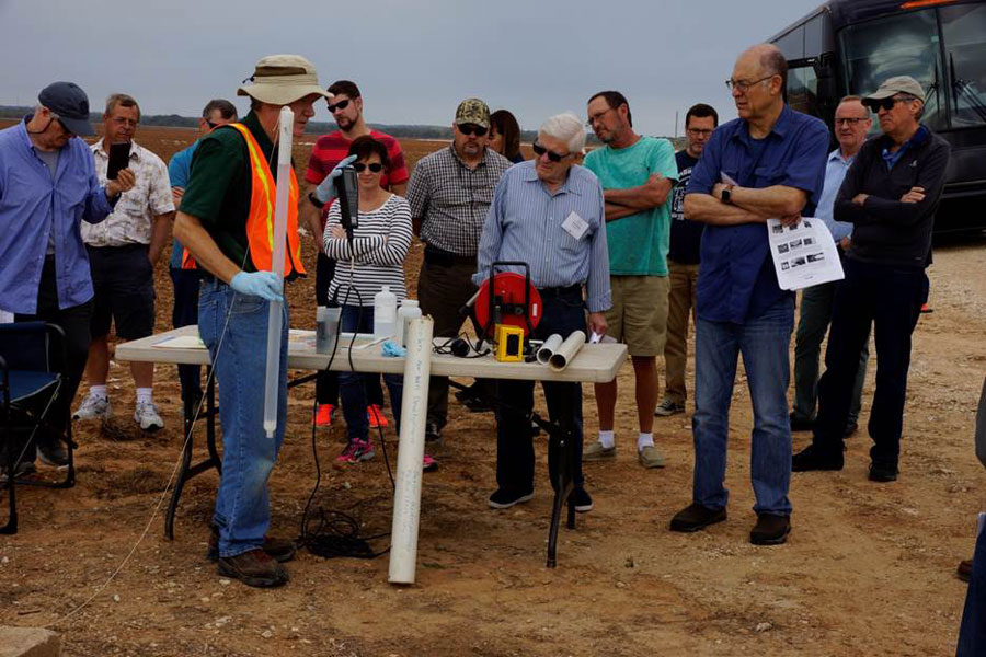 Technical tools demonstrated and explained by an expert at a groundwater site