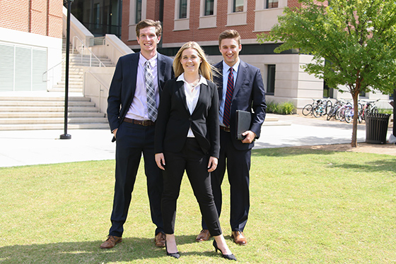 Power pose from Baylor students in business attire