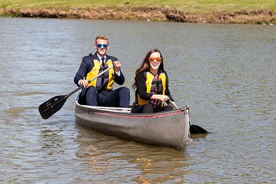 Baylor students at the marina - rowing a kayak