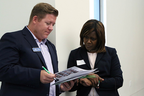 Two colleagues look at paperwork together