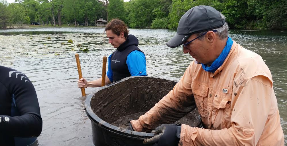 Ecologists study river ecology, collecting water samples