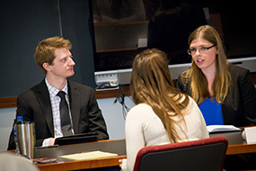 A group of law students shares ideas over a table