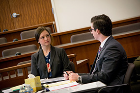 A male and female law student discuss a specific point in a counseling setting