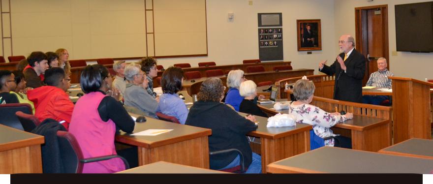 Professor Powell lectures a classroom