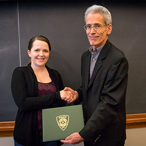 Shaina receives the award from the Baylor Police chief