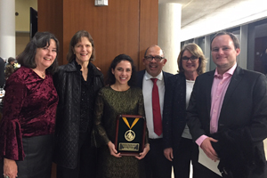 Jimena Tejeda de Valdeavellano receives an award, surrounded by faculty and staff
