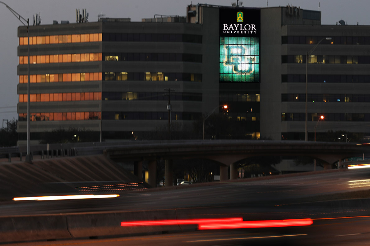 Baylor's Clifton Robinson Tower was transformed into a digital wallscape to impact busy I-35 through Waco. A similar technology presented campaign messages along Stemmons in Dallas.
