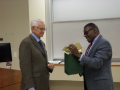 Dr. Simmons presenting Dr. Davis with a thank you for a wonderful lecture