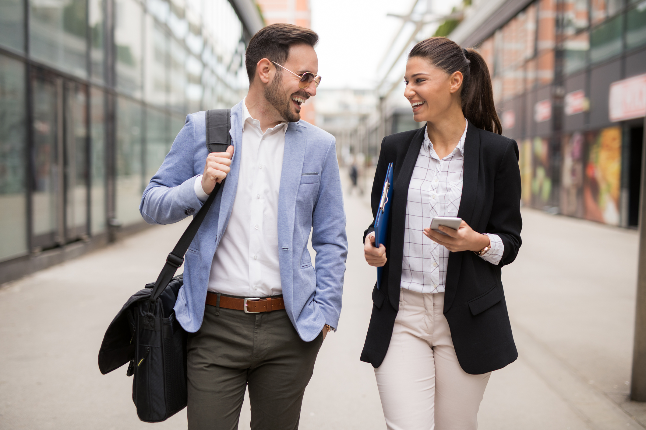 Stock photo of a male and female business colleagues walking