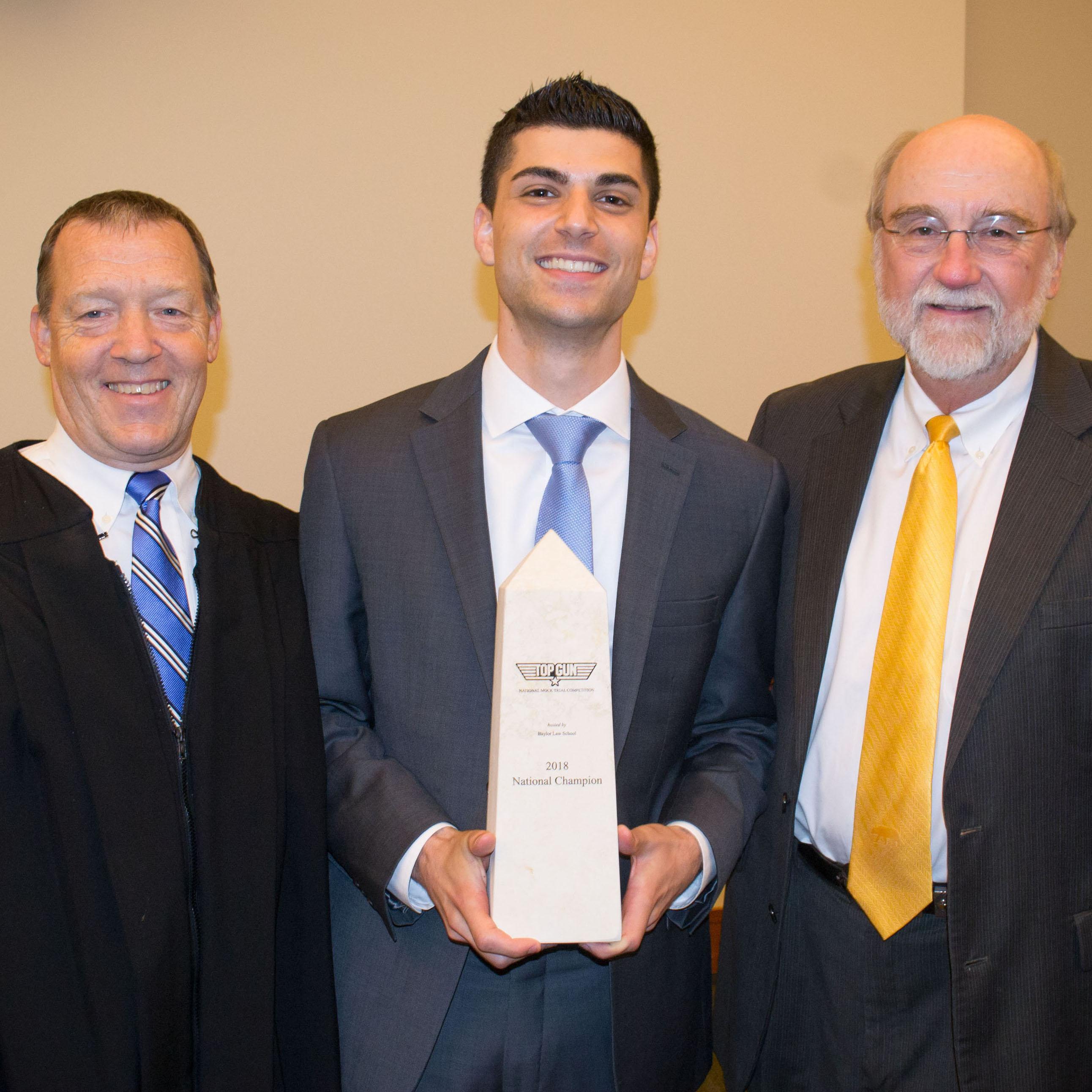 Philip Pasquarello receives his award for Top Gun from Judge Albright and Professor Powell