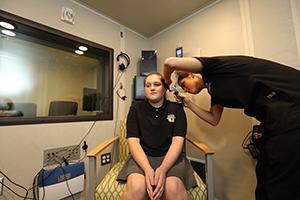 A Medical Professional Examines A Patient's Ear