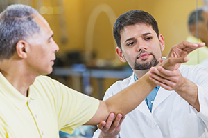 A Medical Professional Evaluates Range of Motion of a Patient's Arm