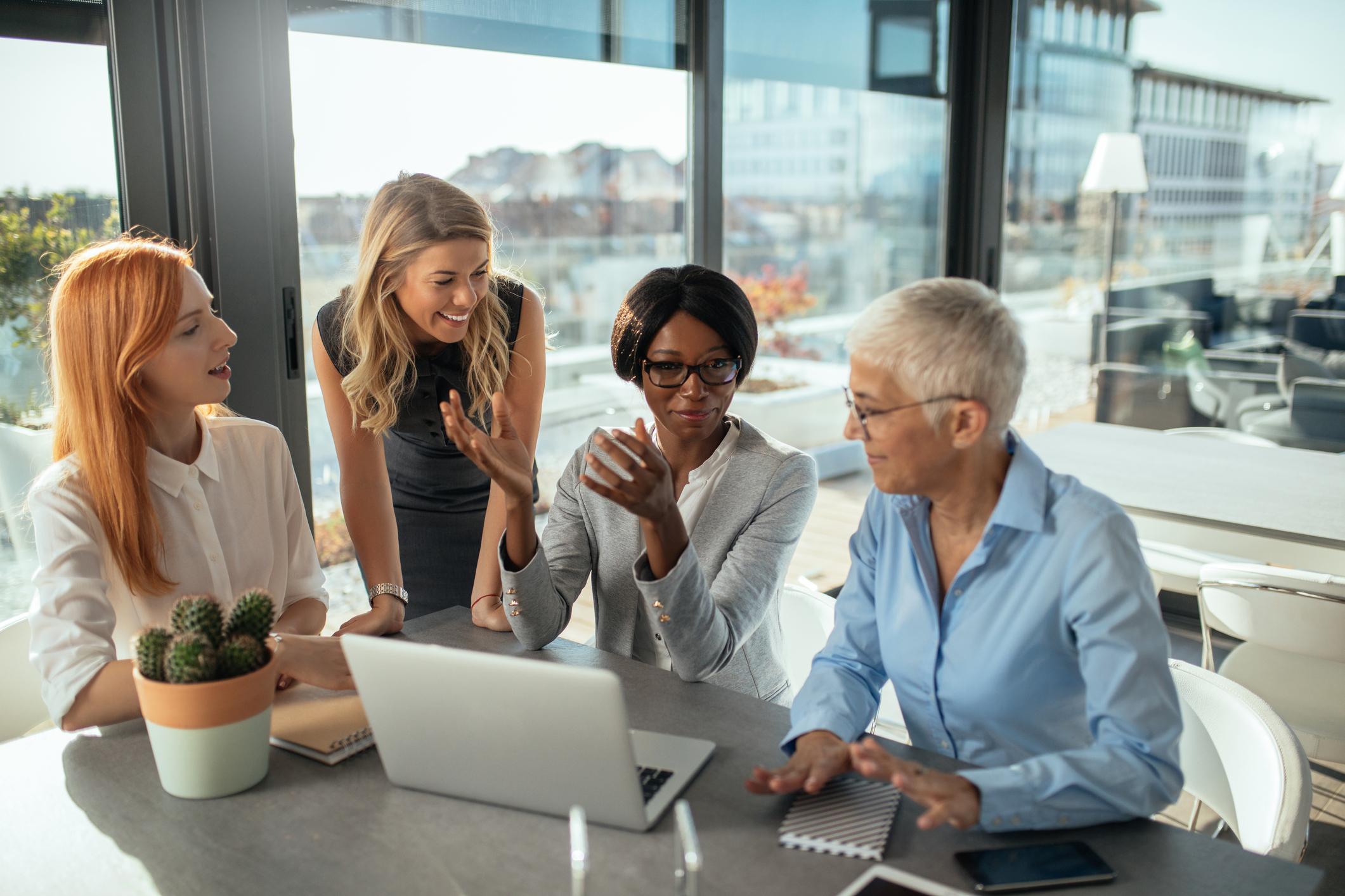 Stock photo of four businesswomen meeting