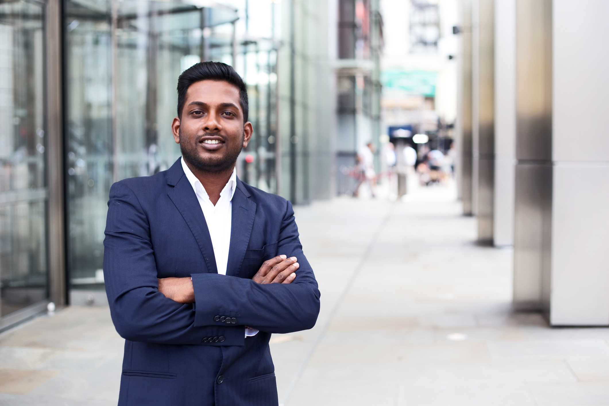 Stock photo of a businessman standing with arms crossed