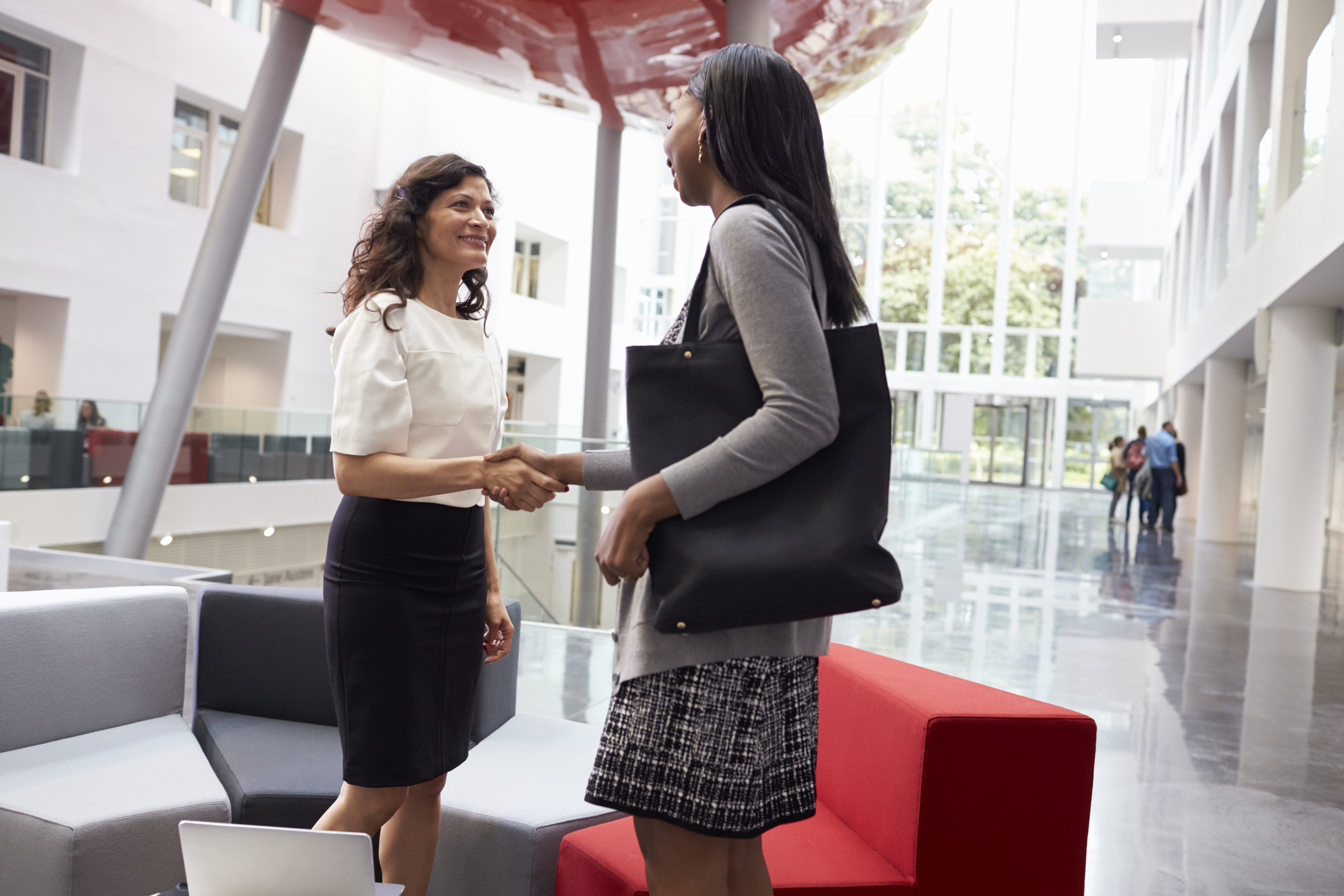 Stock photo of two businesswomen shaking hands