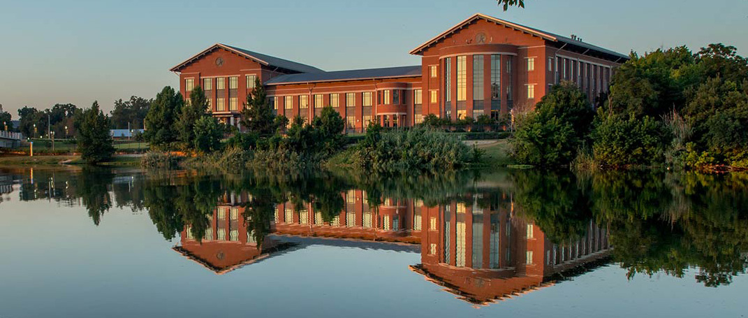 Panoramic photo of Baylor Law School at sunset