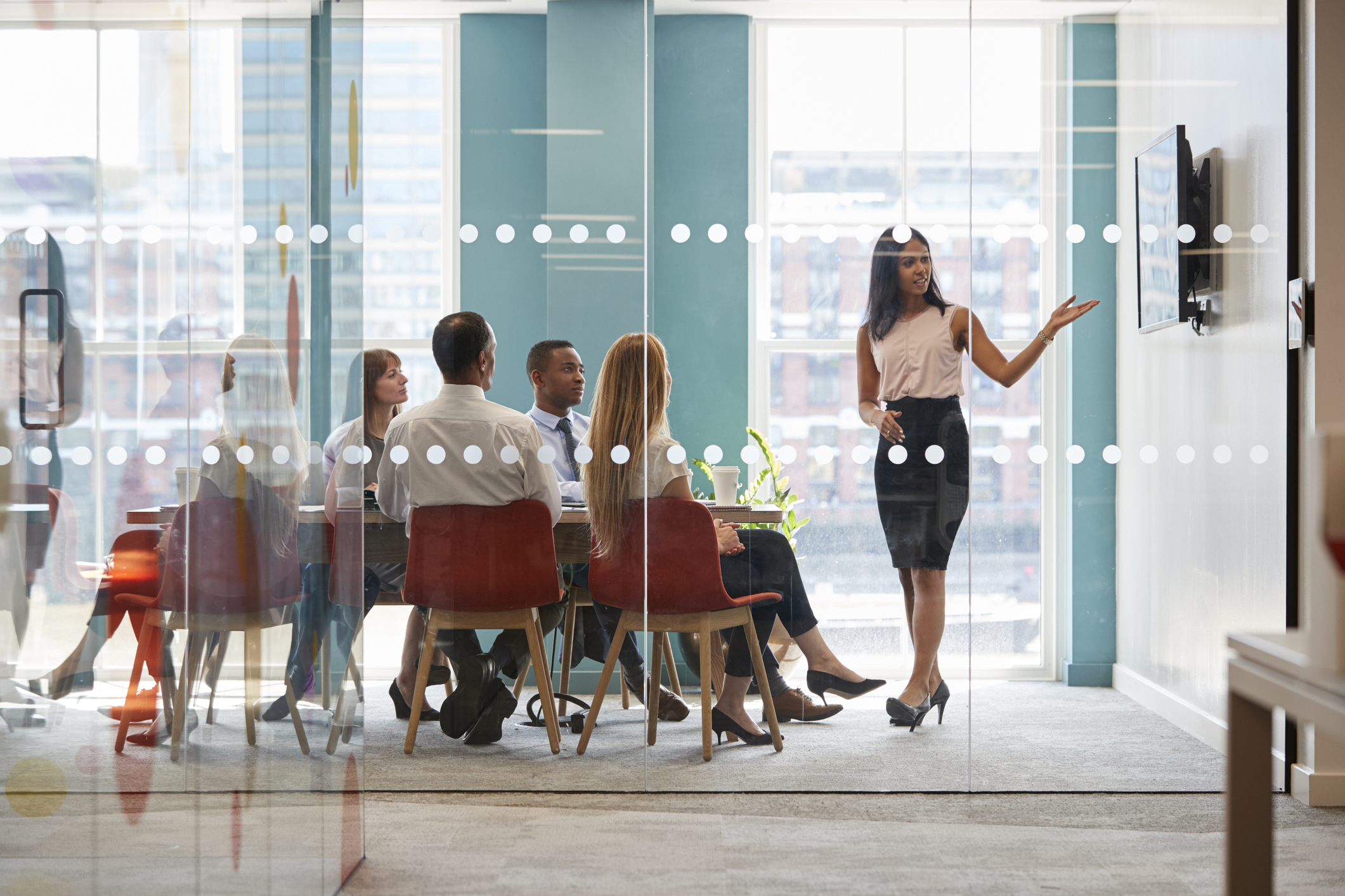 Stock photo of a woman giving a business presentation