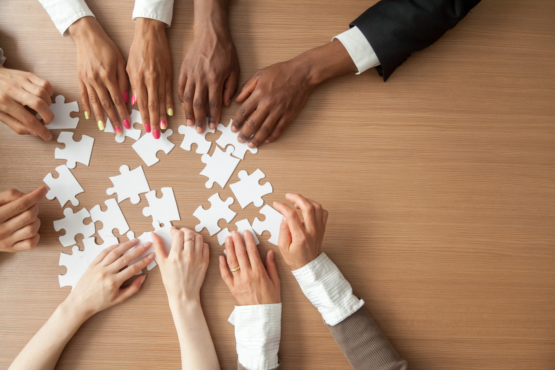 Stock photo of a business team putting a puzzle together