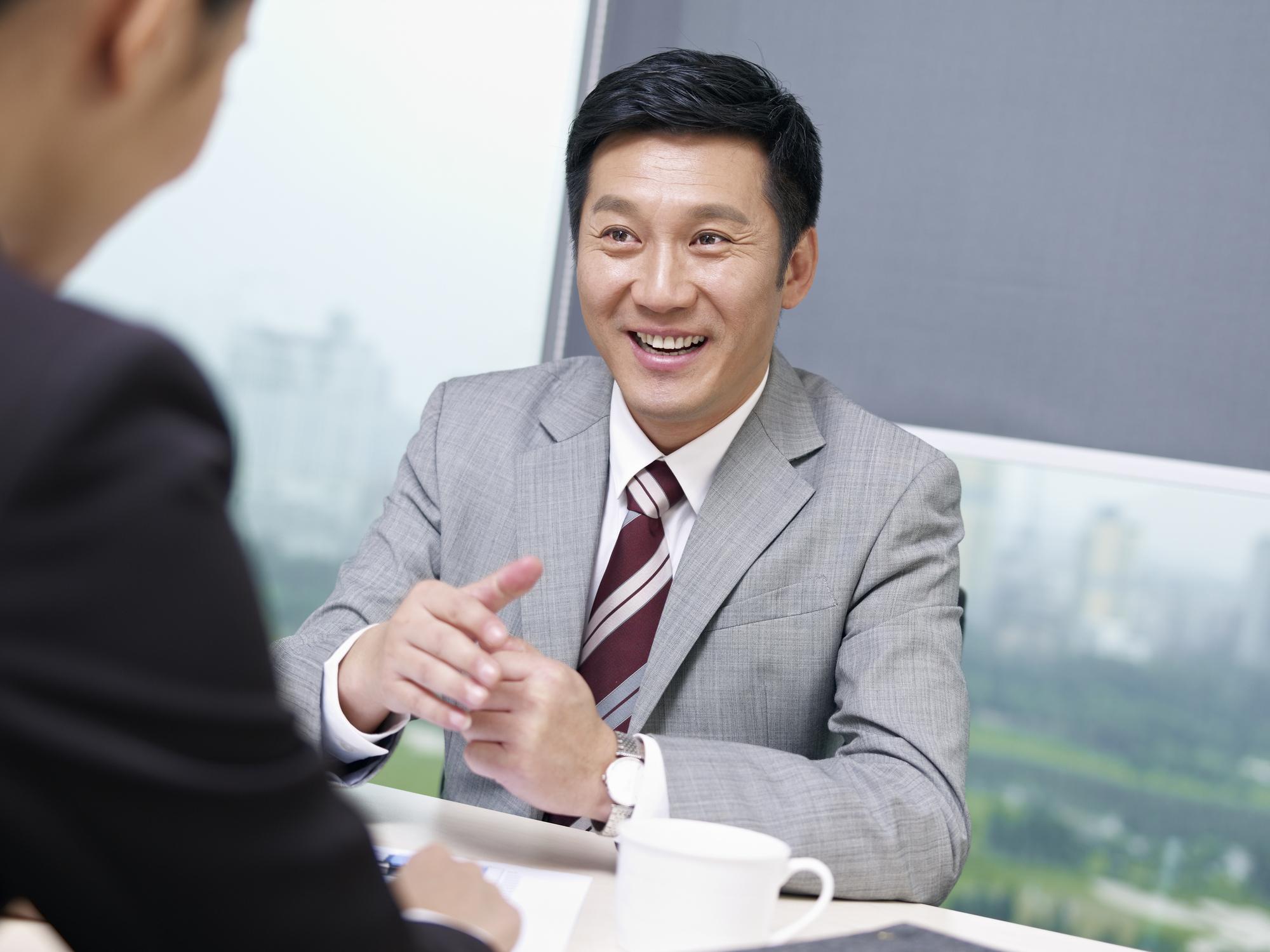 Stock photo of a happy salesman