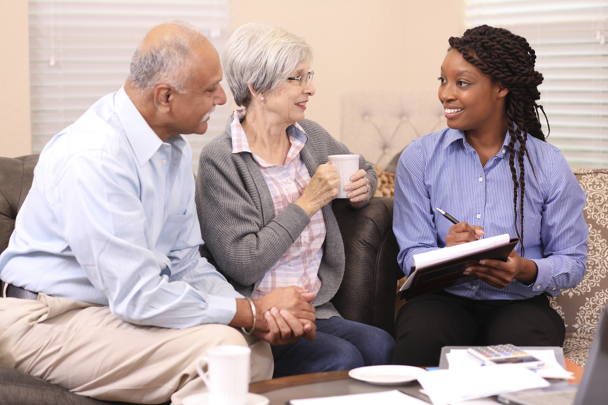 stock photo of elderly couple meeting with a professional