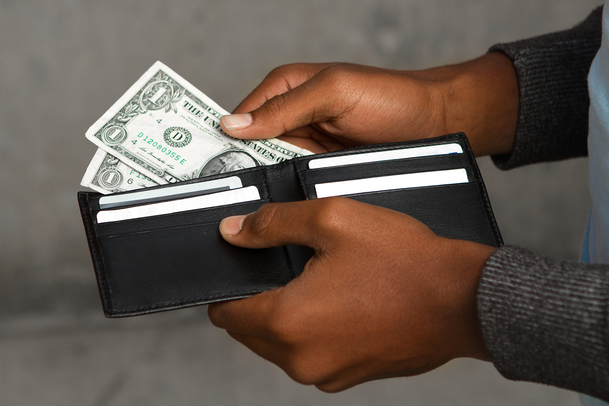 Stock photo of a wallet with two single dollar bills