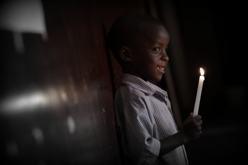 Stock photo of a child holding a candle