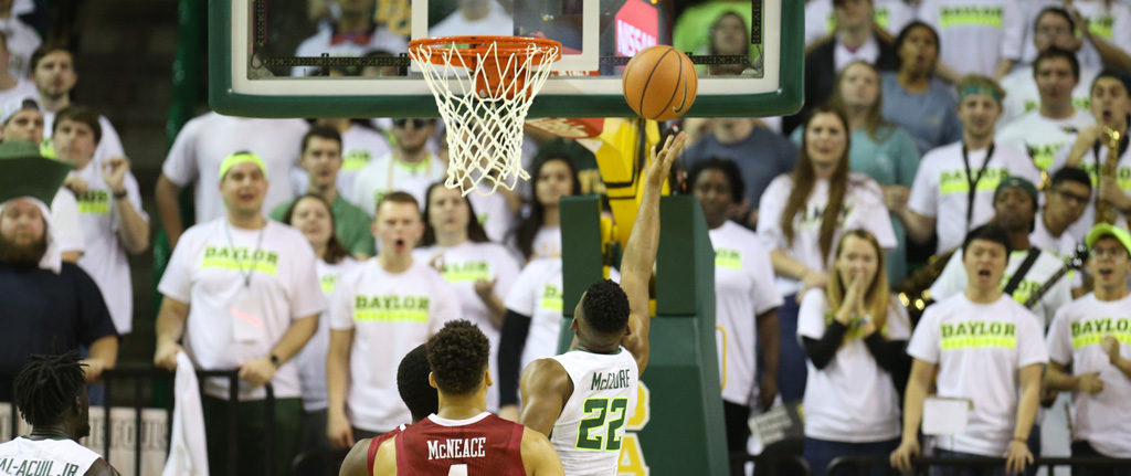 Photo of King McClure laying up a bucket at the Ferrell Center